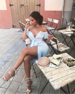 beautiful Latina woman in cafe